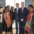 """Le prince William et le prince Harry participent à une réunion des """"Queen's Young Global leaders"""" et enregistrent une vidéo au Buckingham Palace à Londres, le 9 juillet 2014.  9th July, 2014: The Duke of Cambridge and Prince Harry, on behalf of The Queen, launched The Queen's Young Leaders Programme at Buckingham Palace.09/07/2014 - Londres"""