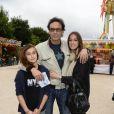 Anthony Delon avec ses filles Liv et Lou - Inauguration de la fête foraine des Tuileries à Paris le 28 juin 2013.
