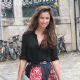 Malika Ménard arrive au Palais des Beaux-Arts pour assister au défilé haute couture Zuhair Murad automne-hiver 2014-2015. Paris, le 10 juillet 2014.