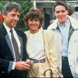 Sacha Distel et Francine avec leur fils aîné Julien au tournoi de Roland-Garros, le30 mai 1990.