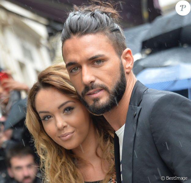 Nabilla Benattia et son compagnon Thomas Vergara au défilé Jean-Paul Gaultier à Paris, le 9 juilllet 2014.