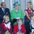 La reine Elizabeth II ravie lors du début du tournoi de hockey aux Jeux du Commonwealth à Glasgow le 24 juillet 2014, premier jour de compétition.