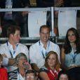 Kate Middleton, le prince William et le prince Harry en tribunes lors d'un match de boxe aux XXe Jeux du Commonwealth, le 28 juillet 2014 à Glasgow.