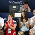 Le prince Harry, Kate Middleton et le prince William au Tolcross Swimming Centre de Glasgow le 28 juillet 2014 pour les épreuves de natation des XXe Jeux du Commonwealth.