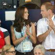 Kate Middleton et le prince William au Tolcross Swimming Centre de Glasgow le 28 juillet 2014 pour les épreuves de natation des XXe Jeux du Commonwealth.