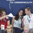 Coup de chaud pour la duchesse de Cambridge ! Kate Middleton et le prince William dans les gradins du Tolcross Swimming Centre de Glasgow le 28 juillet 2014 pour les épreuves de natation des XXe Jeux du Commonwealth.