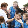 Le prince William, Catherine Kate Middleton, la duchesse de Cambridge et le prince Harry visitent le village des XXèmes Jeux du Commonwealth à Glasgow, le 29 juillet 2014.  Prince William, The Duke of Cambridge, meeting with athletes and youngsters during a visit to the Commonwealth Games Village in Glasgow. 29/07/2014.29/07/2014 - Glasgow