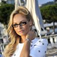 La jolie Adriana Karembeu mariée depuis quelques jours à Aram Ohanian est l'invitée d'honneur de la soirée caritative pour soutenir les associations RMC/BFM et Rayon de Soleil de Cannes, à l'occasion des 10 ans de la Plage Z du Grand Hyatt Hotel Martinez à Cannes le 27 juin 2014.