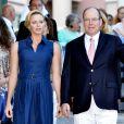 La princesse Charlene de Monaco, enceinte de six mois, et le prince Albert II de Monaco ont participé le 1er septembre 2014 au traditionnel pique-nique des Monégasques, organisé au parc Princesse-Antoinette par la mairie.