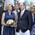 La princesse Charlene de Monaco, enceinte de six mois et superbe, et le prince Albert II de Monaco ont participé le 1er septembre 2014 au traditionnel pique-nique des Monégasques, organisé au parc Princesse-Antoinette par la mairie.