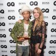 Cara Delevingne et Pharrell Williams lors de la soirée GQ Men of the Year Awards 2014 à Londres, le 2 septembre 2014.
