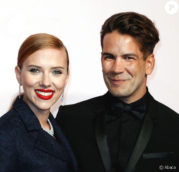 Scarlett Johansson et Romain Dauriac lors de la 39e cérémonie des César au théâtre du Châtelet à Paris, le 28 février 2014.