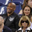 Thierry Henry et sa compagne Andrea Rajacic complices lors du match entre Roger Federer et Gaël Monfils à l'USTA Billie Jean King National Tennis Center de New York, le 4 septembre 2014