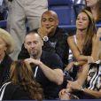 Thierry Henry assiste avec sa compagne Andrea Rajacic au match entre Roger Federer et Gaël Monfils à l'USTA Billie Jean King National Tennis Center de New York, le 4 septembre 2014