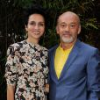 Farida Khelfa et Christian Louboutin à la présentation du documentaire realisé par Farida Khelfa sur Christian Louboutin au cinéma La Pagode à Paris, le 9 septembre 2014. Le film sera diffusé sur Arte le 27 septembre à 22h30.