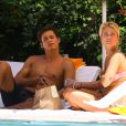 Exclusif - Caroline Receveur et son fiancé Valentin Lucas se relaxent à la piscine de leur hôtel lors de leurs vacances à Miami, le 5 juin 2014.