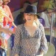 Exclusif - La chanteuse Shakira, son compagnon Gerard Piqué et leur fils Milan se promènent au Tibidabo, un parc d'attractions à Barcelone, le 19 juillet 2014.