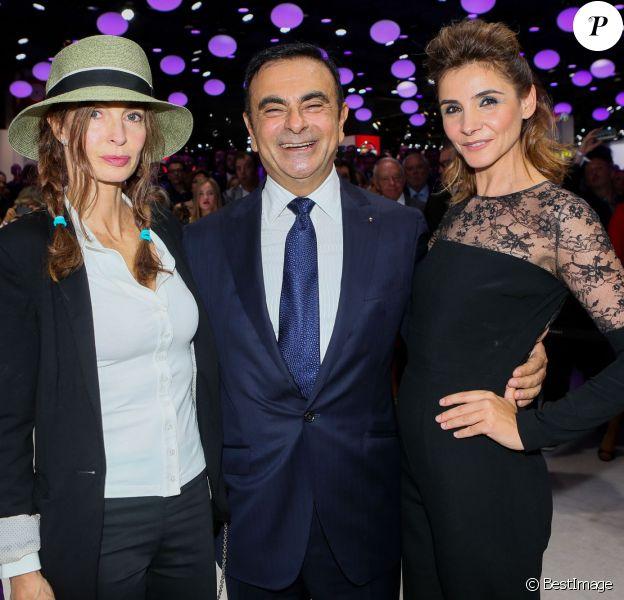 Anne Parillaud, Carlos Ghosn et Clotilde Courau lors de la soirée d'inauguration des nouvelles Renault Espace et Clio lors du salon de l'automobile au Parc des Expositions de la porte de Versailles à Paris, le 2 octobre 2014.