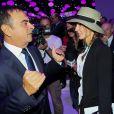 Carlos Ghosn et Anne Parillaud lors de la soirée d'inauguration des nouvelles Renault Espace et Clio lors du salon de l'automobile au Parc des Expositions de la porte de Versailles à Paris, le 2 octobre 2014.