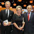Jean-Claude Narcy, Françoise Laborde et Alain Terzian lors de la soirée d'inauguration des nouvelles Renault Espace et Clio lors du salon de l'automobile au Parc des Expositions de la porte de Versailles à Paris, le 2 octobre 2014.