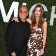 """Michael Kors et Claiborne Swanson Frank à la soirée Michael Kors pour la sortie du livre """"Young Hollywood"""" à Beverly Hills, le 2 octobre 2014."""