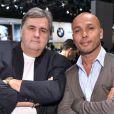 Pierre Ménès et Eric Judor à la soirée Mini au Mondial de l'automobile le 2 octobre à Paris