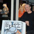 """Philippe Geluck - Vernissage de l'exposition """"Tout L'Art Du Chat"""" de Philippe Geluck à la galerie Huberty-Breyne à Paris, le 14 octobre 2014."""