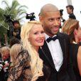 """Tatiana Laurens Delarue et son mari Xavier Delarue - Montée des marches du film """"The Search"""" lors du 67e Festival du film de Cannes. Mai 2014."""
