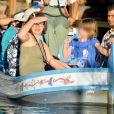 Milla Jovovich enceinte, son mari Paul W. S. Anderson et leur fille Ever Gabo s'amusent à Disneyland à Anaheim en Californie le 23 octobre 2014. La petite famille a passé la journée dans le parc d'attractions, un jour d'école !