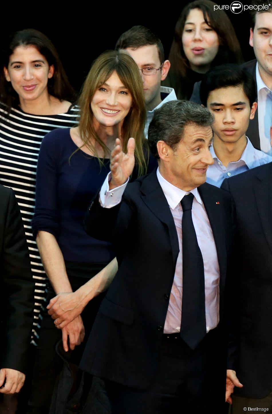 Carla Bruni-Sarkozy et Nicolas Sarkozy lors du meeting de celui-ci à Boulogne-Billancourt le 25 novembre 2014
