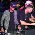 Drake (entouré de son DJ Future the Prince et OB O'Brien) à la PPP Muzik Mansion, nom de la résidence éphémère de Pigalle lors de la foire Art Basel Miami Beach. Le 6 décembre 2014.