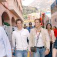 Laure Manaudou et Pierre Henri dans le paddock du Grand Prix de Monaco, le 22 mai 2005