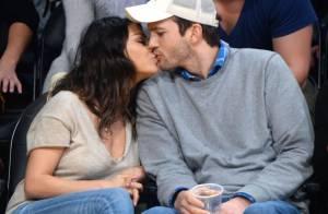 Mila Kunis : Décolleté de sortie et bisous décomplexés avec Ashton Kutcher