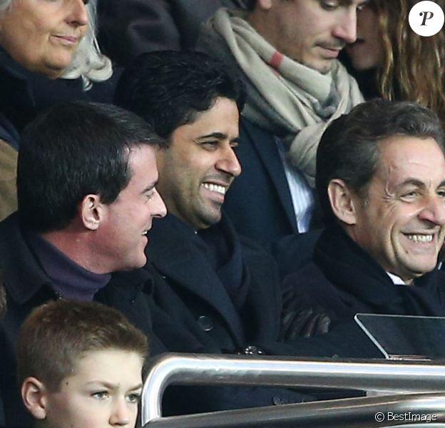 Manuel Valls, Nasser Al-Khelaïfi, Nicolas Sarkozy au match PSG-Montpellier lors de la 19e journée de Ligue 1 au Parc des Princes, le 20 décembre 2014.