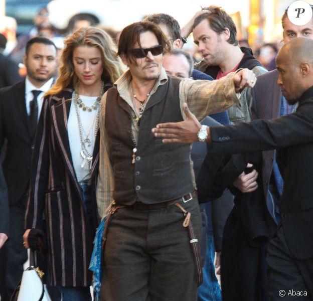 Johnny Depp et Amber Heard arrivent au El Capitan Theatre pour le Jimmy Kimmel Live, Hollywood, Los Angeles, le 15 janvier 2015.