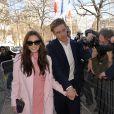 """Elizabeth Olsen et son compagnon Boyd Holbrook - Arrivées des people au défilé de mode, collection prêt-à-porter automne-hiver 2014/2015, """"Miu Miu"""" à Paris. Le 5 mars 2014"""