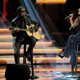 """Kenny 'Babyface' Edmonds et Ariana Grande se produisent au Nokia Theatre L.A. Live lors du concert """"Stevie Wonder: Songs In The Key Of Life - An All-Star Grammy Salute"""" en hommage à Stevie Wonder. Los Angeles, le 10 février 2015."""