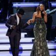"""Ne-Yo et Aisha Morris se produisent au Nokia Theatre L.A. Live lors du concert """"Stevie Wonder: Songs In The Key Of Life - An All-Star Grammy Salute"""" en hommage à Stevie Wonder. Los Angeles, le 10 février 2015."""
