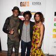 Alicia Fall, accompagnée de deux invités, assiste à la cérémonie des GAFA de la Femme africaine de l'année, qui se tenait au Seven Spirit, à Paris, le samedi 7 mars 2015.