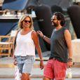 John Mamann et sa compagne Dorothée se promènent à Saint-Tropez, le 27 juillet 2014.