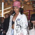 Rihanna arrive au lancement de la collection de chapeaux de son amie Melissa Forde à New York, le 30 mars 2015.