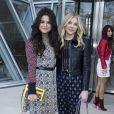 Selena Gomez et Chloë Moretz au défilé Louis Vuitton prêt-à-porter collection Automne-Hiver 2015-2016 à Paris, le 11 mars 2015.