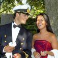 Le prince Carl Philip de Suède et sa petite amie de l'époque Emma Pernald en août 2003 au mariage d'Andrea Brodin et Niclas Engsall.