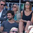 Laure Manaudou et son compagnon Jérémy Frérot lors de la finale masculine des Internationaux de France à Roland-Garros le 7 juin 2015 à Paris