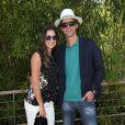 Gustavo Kuerten et son épouse Mariana Soncini au Village avant la finale masculine des Internationaux de France à Roland-Garros le 7 juin 2015 à Paris