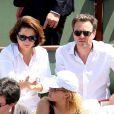 Guillaume de Tonquédec et sa femme Christèle dans les tribunes de Roland-Garros lors de la finale homme, le 7 juin 2015 à Paris