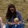 The Duchess of Cambridge with Prince George, as the Duke of Cambridge and Prince Harry take part in a charity polo match at Beaufort Polo Club in Tetbury, Gloucestershire , UK, on Sunday June 14, 2015. Photo by Steve Parsons/PA Wire/ABACAPRESS.COM14/06/2015 - Gloucester
