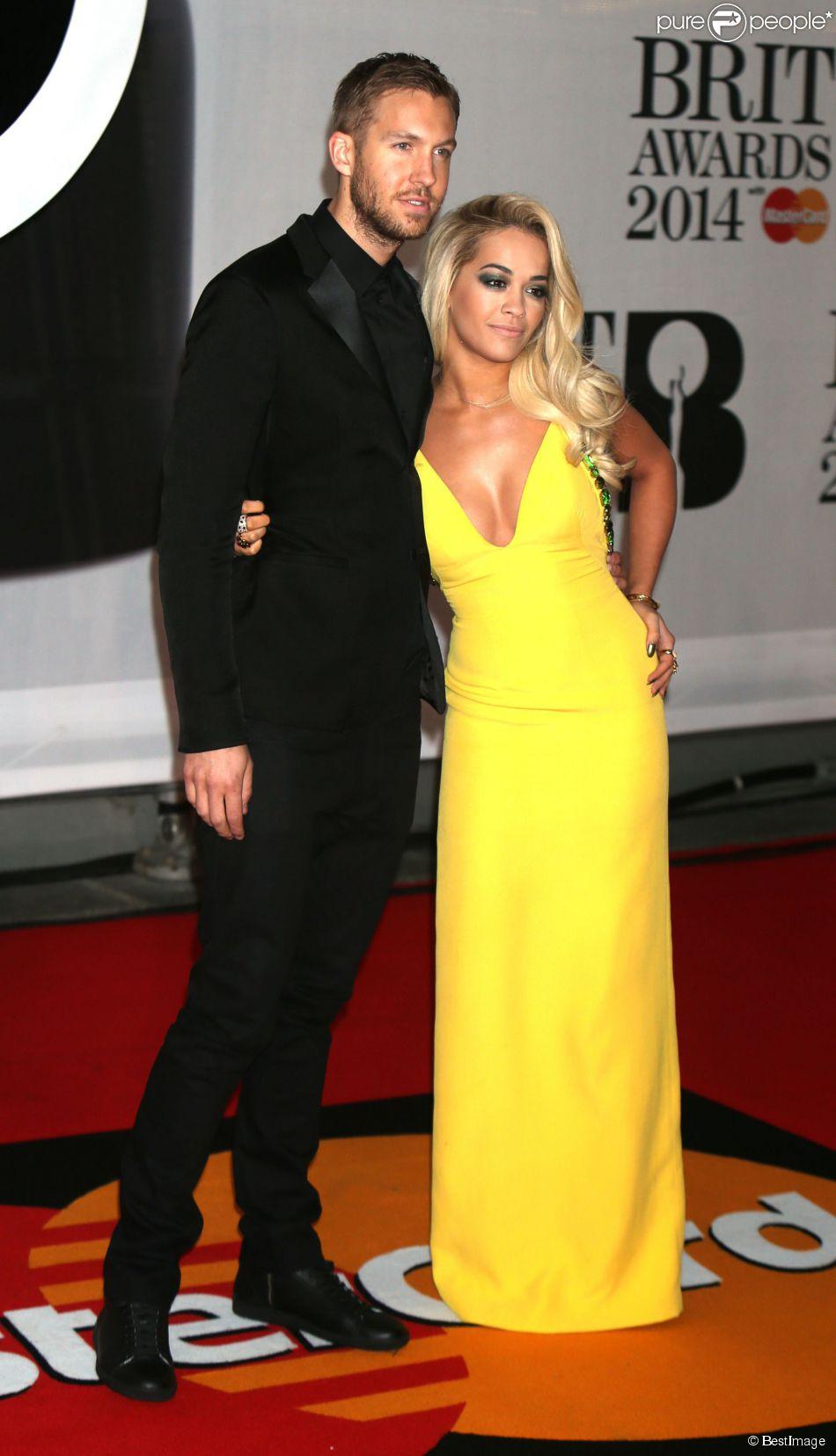"""Rita Ora et son petit-ami Calvin Harris - Personnalités arrivant à la soirée des """"Brit Awards 2014"""" en partenariat avec MasterCard à Londres, le 19 février 2014."""
