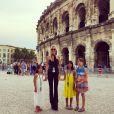 Laeticia Hallyday et ses filles, Jade et Joy, aux arènes de Nîmes, le 2 juillet 2015.