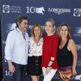 Exclusif - Christophe Bonnat, Virginie Coupérie-Eiffel, Julie Gayet et Coco Coupérie-Eiffel, lors du premier jour du Longines Paris Eiffel Jumping au Champ-de-Mars à Paris, le 3 juillet 2015.